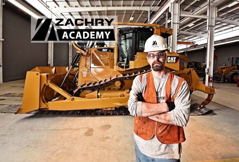 Zachry employee in front of tractor